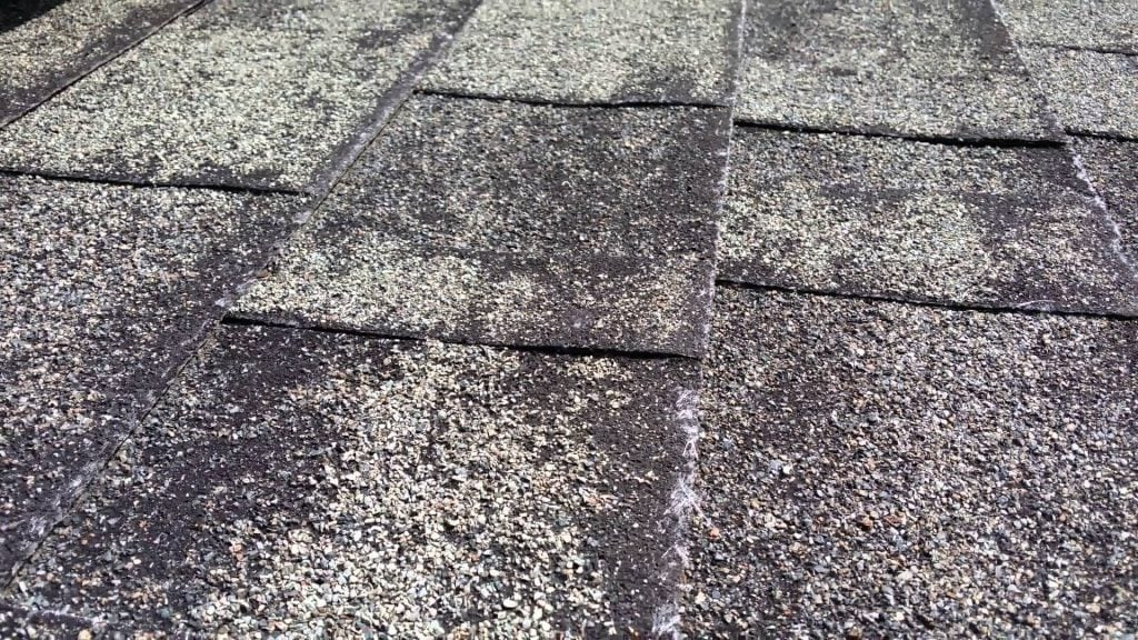 Damaged shingles due to using high pressure on a roof